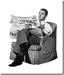 newspaper-man reading paper in armchair