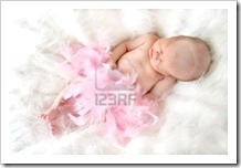 5582953-new-born-baby-sleeping-on-a-soft-fur-background-and-covered-in-pink-feathers-with-a-soft-focus-to-ad