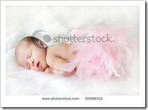 stock-photo-sleeping-baby-covered-in-pink-feathers-with-a-soft-focus-for-elegance-35968312
